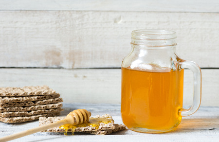 dipper: Honey jar with dipper and flowing honey