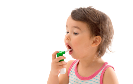 respire: Little sick girl used medical spray for breath Stock Photo