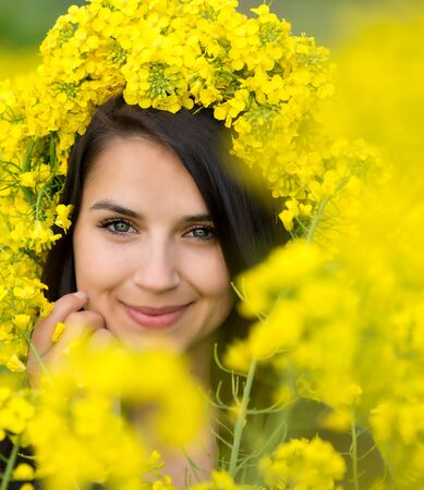 adult rape: Portrait of young woman in the rape, colza field Stock Photo