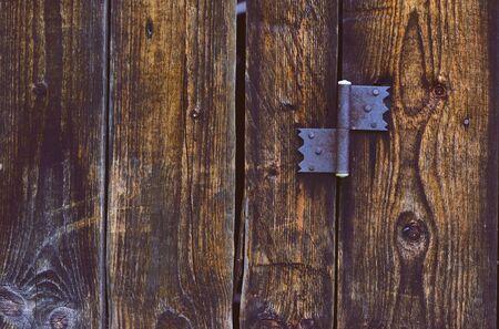 hinge: old rusty hinge on wooden door