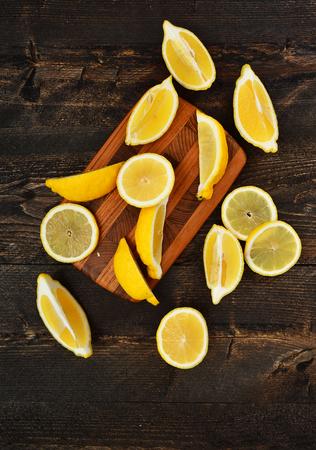 lemon slices: Lemon slices on wooden background Stock Photo