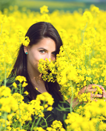 adult rape: portrait of a beautiful girl in the colza field