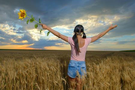 worshipper: Woman feeling free in a beautiful natural setting.