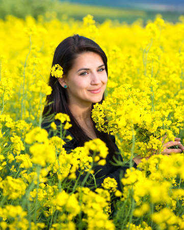 limp: portrait of a beautiful girl in the colza field