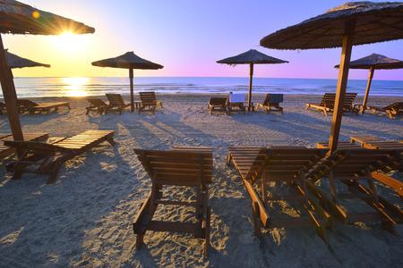 sun umbrellas: Sun umbrellas and sunbeds on beautiful sandy beach