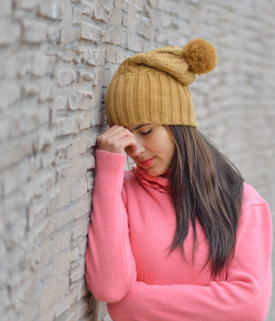 Close-up of a sad and depressed  woman deep in thought outdoors with copy space Stock Photo