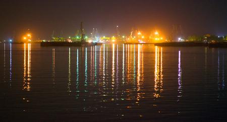 Port warehouse at night Stock Photo