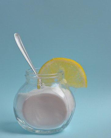 Sodium bicarbonate in a glass and lemon