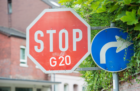 ingenious way to protest against G20. Sticker on a stop street sign Stock Photo