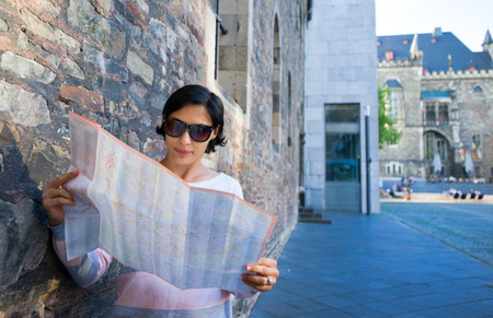 Woman with map in the street. Standard-Bild