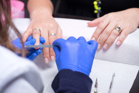 Nail care in salon. Selective focus on costumers nails.