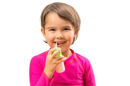 Little sick girl used medical spray for breath Standard-Bild