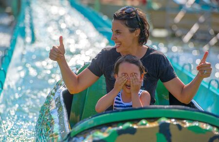 Mother and her daughter having fun in waterpark