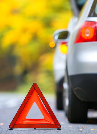 Broken car concept, breakdown triangle on road