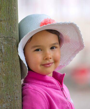 little girl with white summer hat Standard-Bild