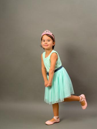 Full length of little fashion girl in studio Standard-Bild