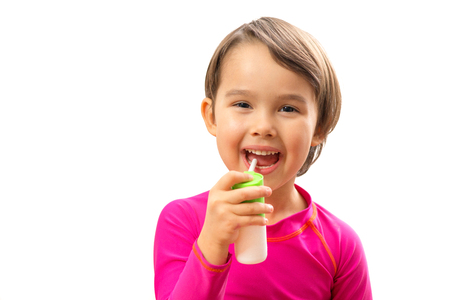 Little sick girl used medical spray for breath Stock Photo