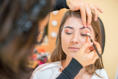 young woman at salon for a make up Standard-Bild - 110837636
