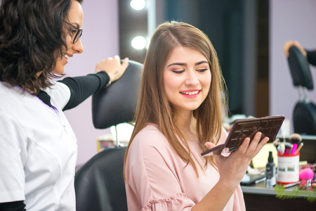 young woman at salon for a make up Standard-Bild - 106318250