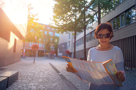 Woman with map in the street. Standard-Bild - 106318289
