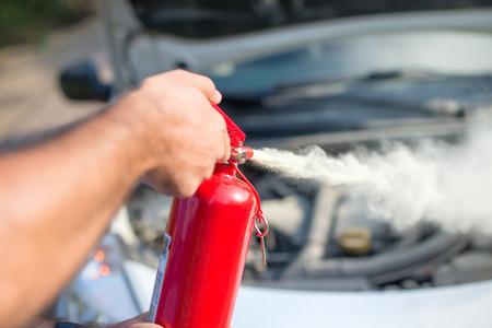 Man using car to extinguish a car fire. Close up shot