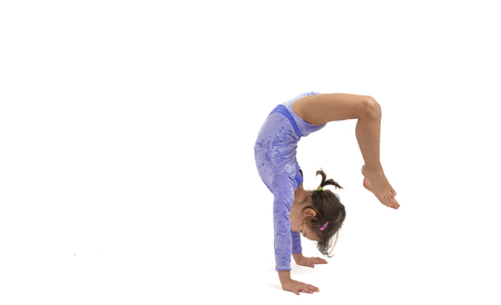 Little gymnast on a white background. Sporting exercise, stretch, flexibility, aerobics