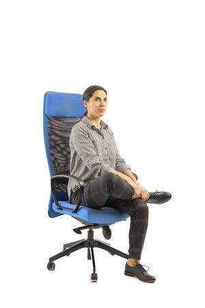 Woman doing exercises while she is sitting on office chair, isolated on white