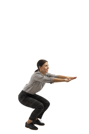 Young businesswoman isolated on white background doing exercises