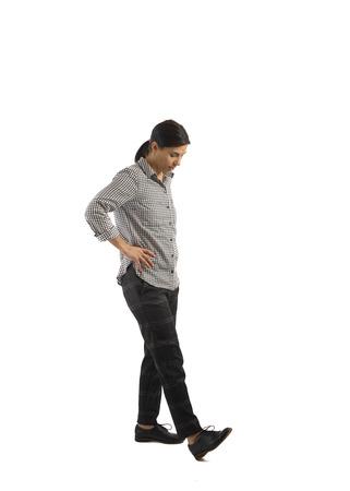 Joven empresaria aislada sobre fondo blanco haciendo ejercicios Foto de archivo