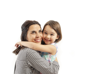 Portrait of happy daughter embraces her mother, isolated on white background