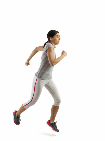 woman running isolated on white background, fitness healthy lifestyle concept Stock Photo