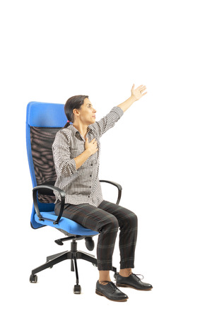 Woman sitting on her office chair and doing exercises