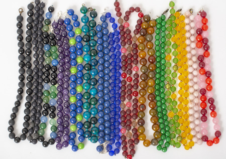 Mixed colors beads close-up made from natural stones or glass marbles