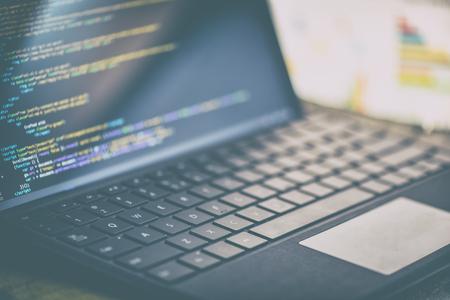 Closeup coding on screen,  coding html and programming on screen laptop, web development, developer