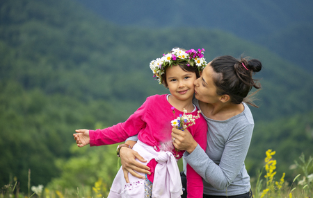 Smiling mother and little daughter on nature. Mother day Stock Photo