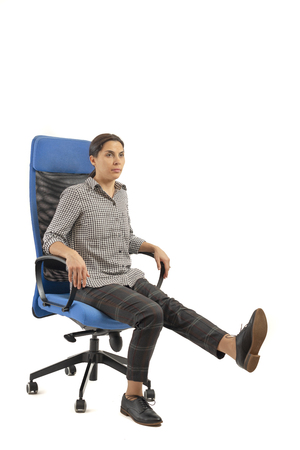 Woman doing exercises on the neck sitting in the chair at the office Banco de Imagens