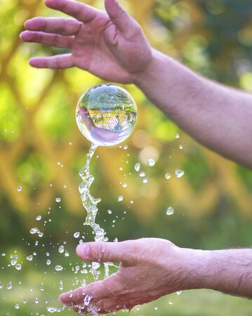 throwing a glass ball into the air Stock fotó - 129969514