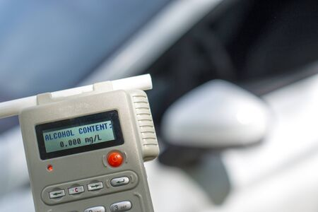 analyzer of alcohol with car in background Stock fotó - 129955832