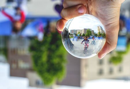 Child playing in park  through the lensball