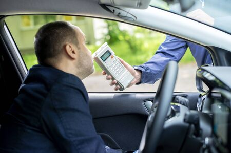 Driver due to being subject to test for alcohol content with use of breath analyzer