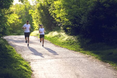 Young people jogging and exercising in nature