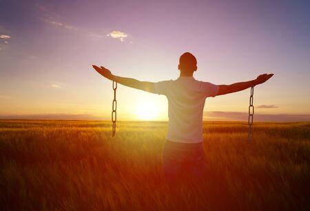 Man feeling free in a beautiful natural setting. Stock fotó