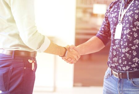 man shaking hands as an agreement in the office