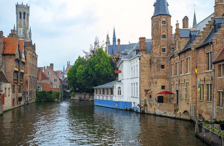BRUGES, BELGIUM - August 10, 2017. Tourist boat on canal in Bruges in a rainy day Stock fotó