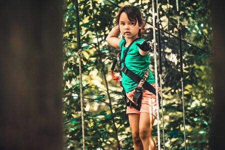 little girl in the adventure park in summer time Stock fotó