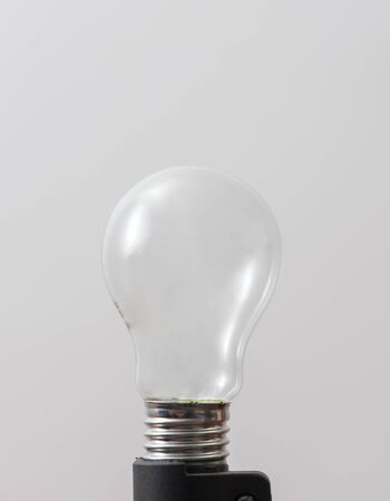light bulb without filament over white background
