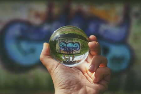 Pictures on the wall through the lensball Stock fotó
