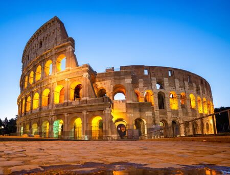 Night view of Colosseum in Rome, Italy. Rome architecture and landmark. Rome Colosseum is one of the main attractions of Rome and Italy Фото со стока