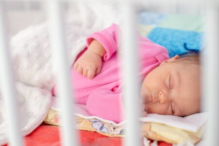 Cute little newborn girl sleeping in her bed Stok Fotoğraf