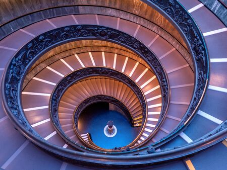 ROME, ITALY - OCTOBER 21, 2019: The Bramante Staircase is a double helix, having two staircases allowing people to ascend without meeting people descending